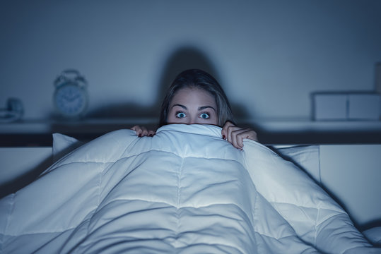 Woman watching an horror movie