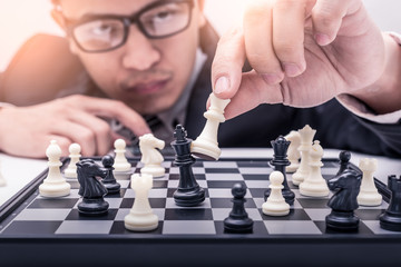 the abstract image of the businessman take a checkmate on the chess board during the chess game. the concept of strategy, victory, business, win, games, intelligence and education.