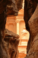 The Treasury (Al Khazneh) through the colorful sandstones of the Siq Canyon in Petra, Jordan, Middle East