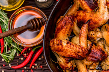Baked chickens wings covered in honey, vegetables