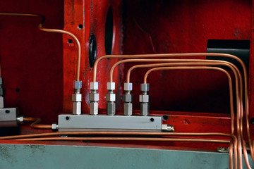 Hydraulics oil station on the machine tool on industrial equipment. Lubrication system with oil under pressure.