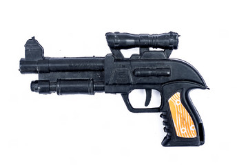 A black colored  toy gun isolated on white.