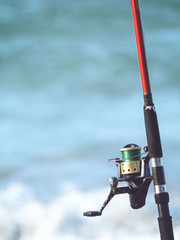 Fishing rod, spinning, reel, close-up, sea