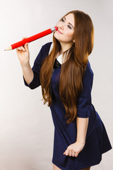 Student girl looking elegant woman holding big pencil