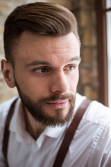 Happy portrait of smiling handsome bearded man in white shirt with very good mood.