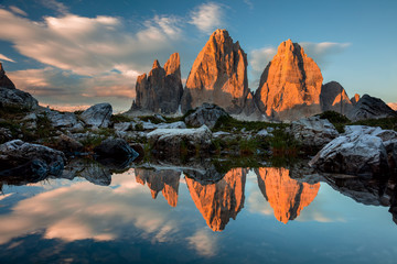 Tre Cime di Lavaredo with reflection in lake at sundown, Dolomites Alps