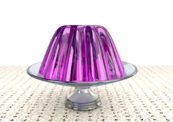 gelatina colorida em prato de vidro sobre fundo branco