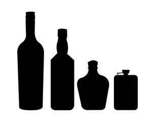 Assortment of three bottles with alcohol and a flask