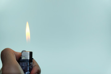 Hand holding the lighter isolated on white background, Gas lighter