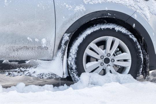 SUV car in winter.Urban traffic problem in winter.car got stuck in the deep snow