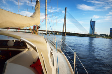 View forward from a sailboat passing under the bridge in Riga, Latvia