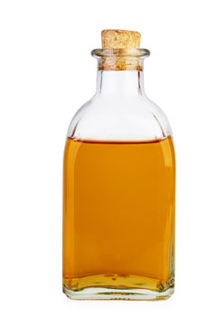 Glass bottle with apple vinegar isolated on the white background