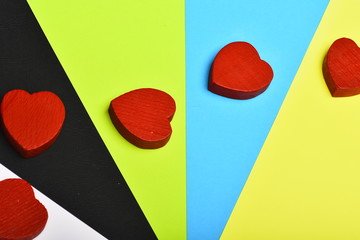 Red hearts on colourful background, top view