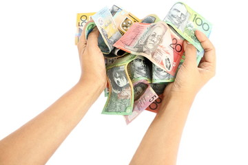 Asian woman hand taking group of colorful australian money banknote dollar (AUD) pile on white background like heart shape