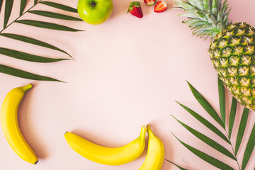 Fresh Fruits and Leaves on pink background. Natural Organic Food Style. Wall mural