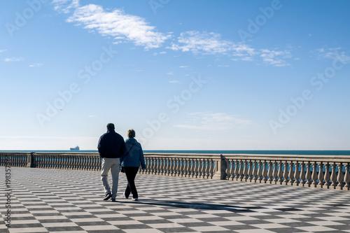 Couple walking on the famous Terrazza Mascagni in Livorno, Tuscany ...