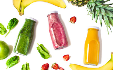 Colorful smoothies in bottles isolated on white background, top view. Natural Organic Food Style.