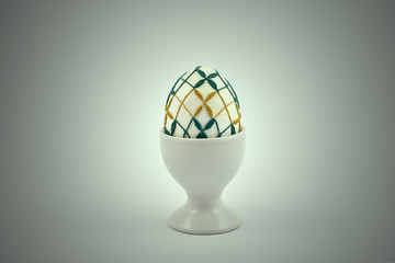 Decorated easter egg stock images. Spring decoration images. Simple ceramic egg stand. Crocheted Easter Egg