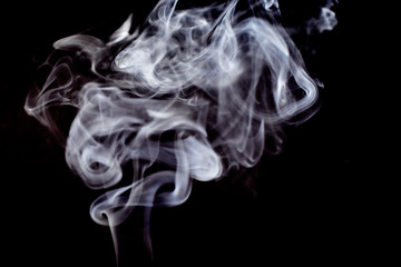 Smoke on a black background stock images. Abstract smoke background. Dark background with smoke