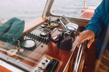 Hand holds the yacht's yoke
