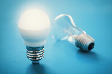 Illuminated LED lamp near reclining incandescent lamp