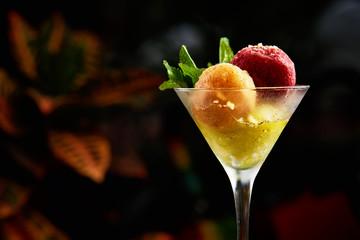 Red and orange ice cream balls sweet summer dessert