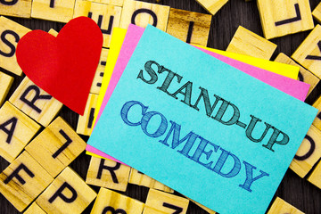 Handwritten text showing Stand Up Comedy. Conceptual photo Entertainment Club Fun Show Comedian Night written on colorful sticky note on the letter background Love Heart for Loving
