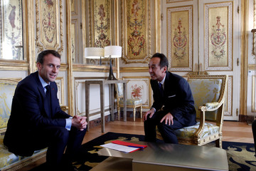 France's president Emmanuel Macron attends a meeting with President and Chief Strategy Officer of Samsung Electronics Young Sohn at the Elysee Palace in Paris