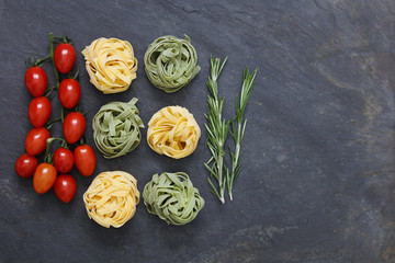Ingredients for Italian pasta meal with tagliatelle, garlic and penne pasta