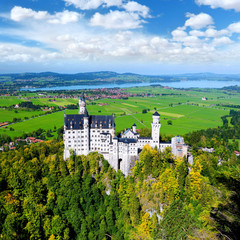 Fototapete - Famous Neuschwanstein Castle, 19th-century Romanesque Revival palace on a rugged hill above the village of Hohenschwangau in southwest Bavaria, Germany
