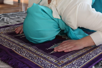 Young beautiful Muslim  on the floor in the mosque.