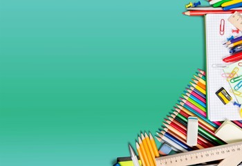 Colorful school supplies on background