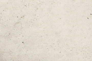 Texture of old organic light cream paper with wrinkles, background for design with copy space text, image. Recyclable material,with small inclusions of cellulose