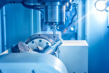 High precision CNC machining center working, operator machining automotive sample part process