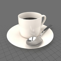 Full coffee cup with spoon