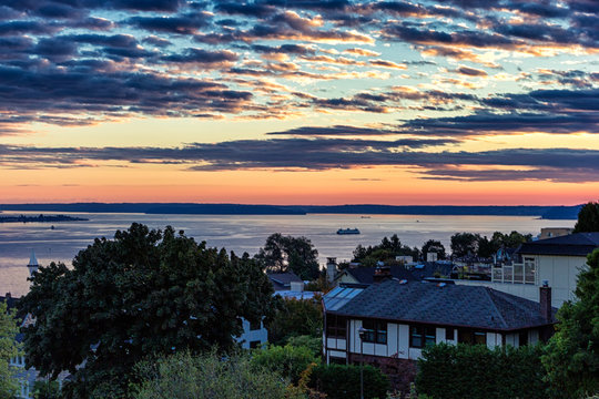 Colorful sunset over the houses in Seattle with a sea view