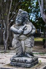 Stone statue near Pura Segara Desa Adat in Kuta, Bali, Indonesia
