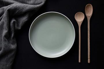 empty plate on dark background