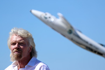Branson listens to speeches as he is inducted into the Flight Path Walk of Fame in Los Angeles