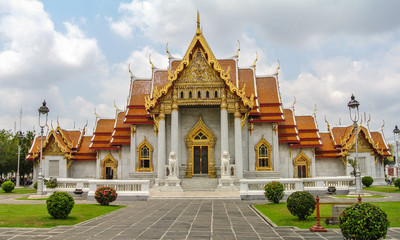 Wat Benchamabophit is a Buddhist temple in Bangkok capital of Thailand. Also known as the marble temple, ornate style of high gables a major tourist attraction.