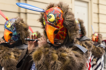 Basel carnival. Steinenberg, Basel, Switzerland - February 21st, 2018. Close-up of a carnival participant with a bird shaped mask