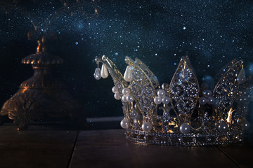 low key image of beautiful queen/king crown. fantasy medieval period. Selective focus.