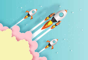 Paper art style of rockets flying in space, start up concept, flat-style vector illustration.