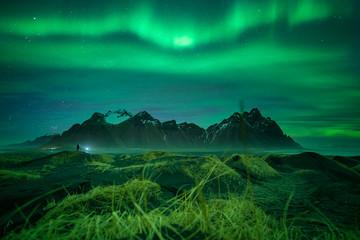 Northern lights at vesturhorn mountain iceland with aurora