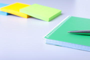 Business concept. Top view of kraft spiral notebook, glasses and pen isolated on background for mockup.