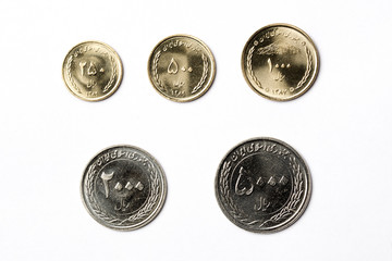 Iranian coins on a white background