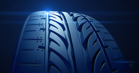 Close up car tire with depth of field and lens flare