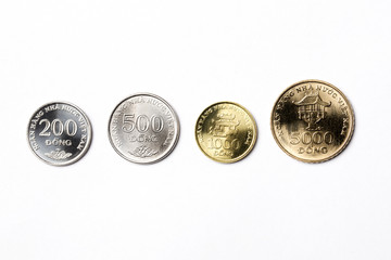 Vietnamese coins on a white background