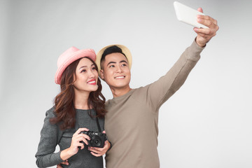 Asian couple take a picture together, smiling and having fun
