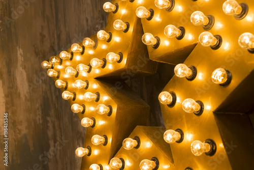Large wooden star with a large number of lights are lit. Beautiful ...